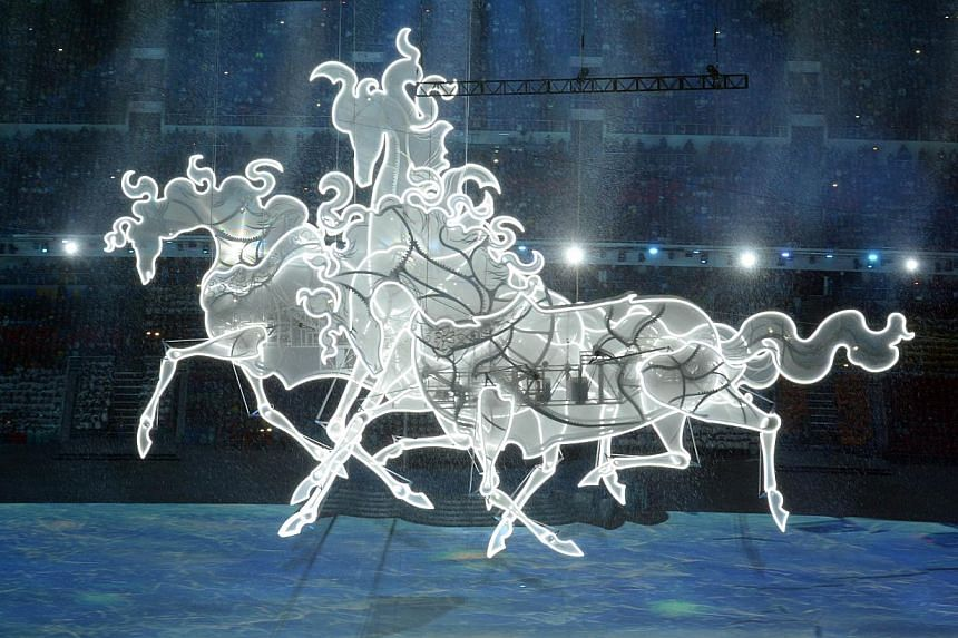 Illustrations of galloping horses float along during the Opening Ceremony of the Sochi Winter Olympics at the Fisht Olympic Stadium on February 7, 2014. --PHOTO: AFP