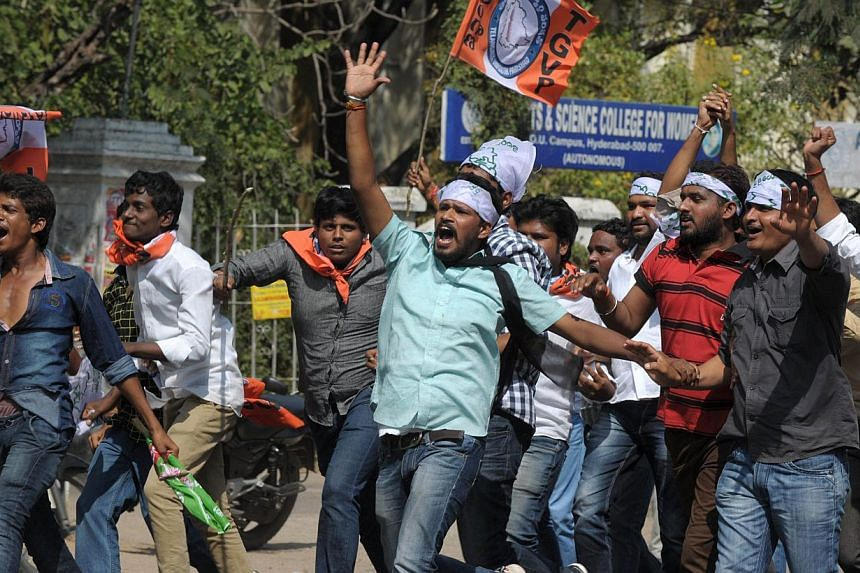 Indian students of the Telangana Joint Action Committee (T-JAC) shout slogans as they march towards the 'Assembly' during a pro-Telangana protest in Hyderabad on January 6, 2014. -- PHOTO: AFP