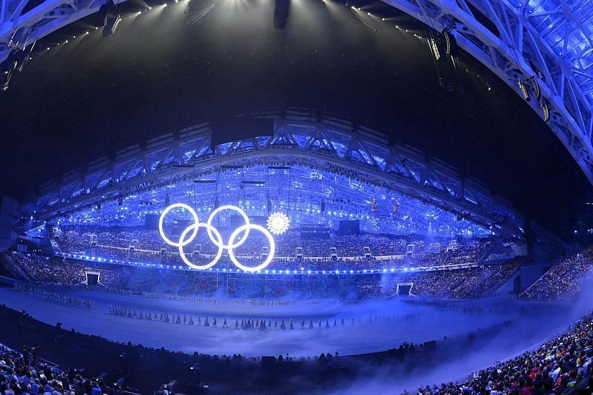 Four of the five Olympic rings are seen during the Opening Ceremony of the Sochi Winter Olympics at the Fisht Olympic Stadium on Feb 7, 2014 in Sochi.Russian television chief Konstantin Ernst admitted that TV pictures of the Olympic rings glitc