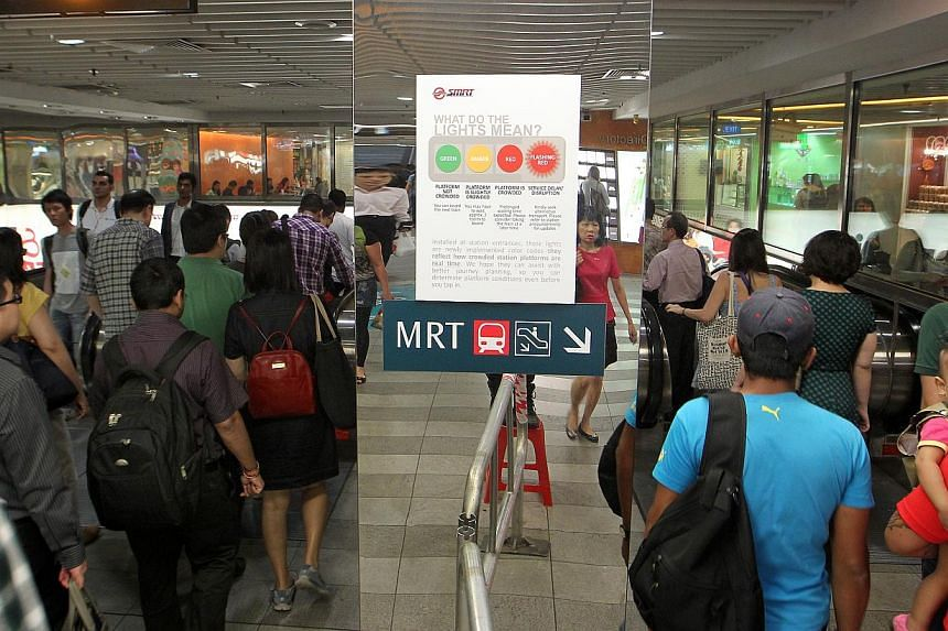 The ''traffic light'' signal at Tanjong Pagar MRT station showing an amber light. This means commuters have to wait for approximately two trains to pass before they can board. -- ST PHOTO: NEO XIAOBIN