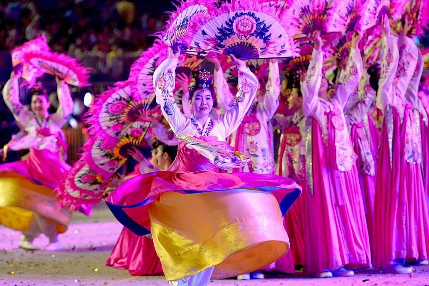 South Korea's Sunhwa Dance Troupe performing a fan dance and flower crown dance, one of the country's oldest court dances. -- ST PHOTO: LIM SIN THA
