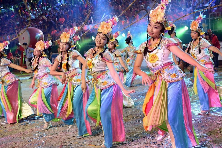 Some of the 700 local dancers showing off their moves in a classical Chinese dance item at the parade. -- ST PHOTO: LIM SIN THAI