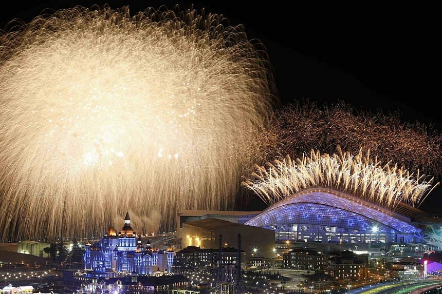 Fireworks explode after the Olympic Cauldron is lit during the opening ceremony of the Sochi 2014 Winter Olympics on Feb 7, 2014. -- PHOTO: REUTERS