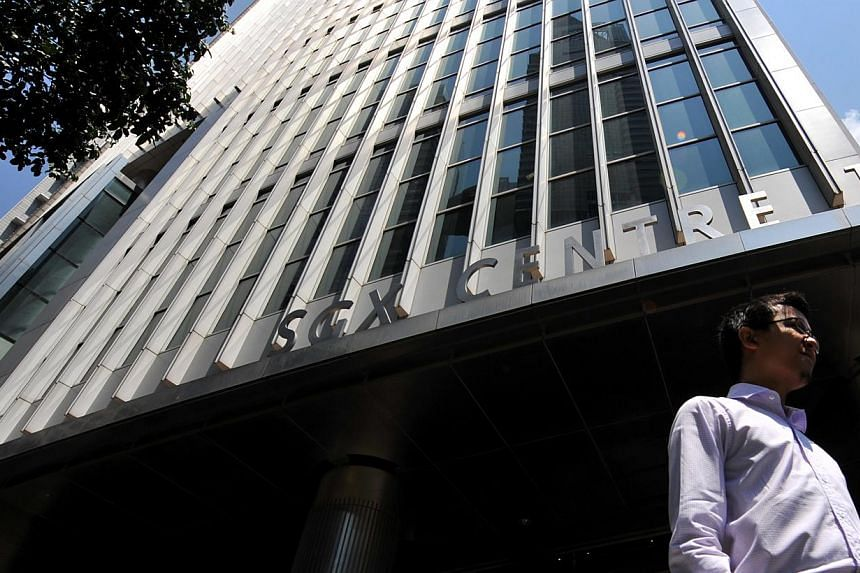 A man walks past the Singapore Exchange building at Shenton Way. Share trading in Singapore could be headed for some major changes in the wake of last October's penny stock crash if new proposals by regulators go ahead. -- ST FILE PHOTO: KUA CHEE SIO