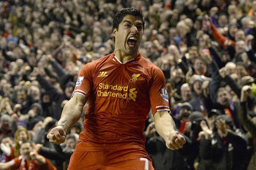 Liverpool's Luis Suarez celebrates after scoring a goal against Everton at Anfield on Jan 28, 2014. An in-form Suarez willbe one of the key factors to a Liverpool win against Arsenal on Saturday night, according to former Reds legend John Barne