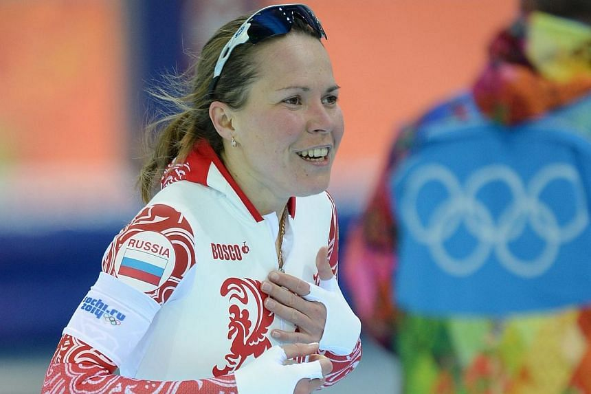Russia's Olga Graf celebrates after wining the bronze medal in the Women's Speed Skating 3000m at the Adler Arena during the Sochi Winter Olympics on Feb 9, 2014.Russia on Sunday breathed a sigh of relief after the host nation of the Sochi 2014