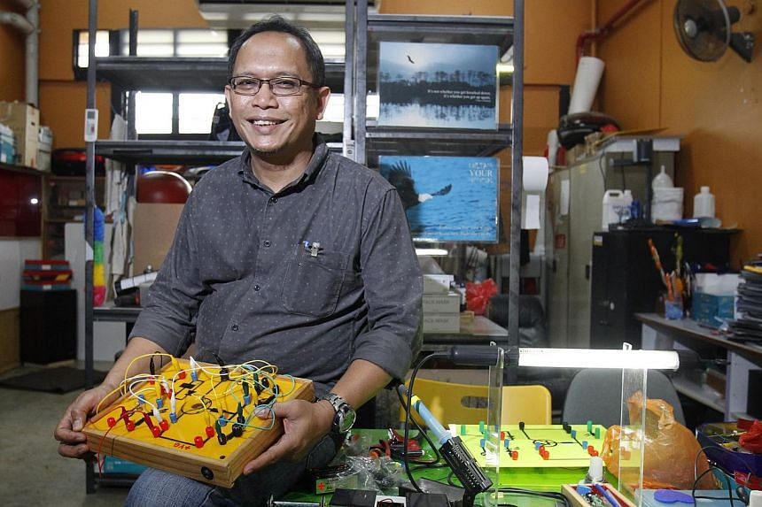 Mr Iskandar Asmon, 50, quit his engineering job at 48 and decided to become a teacher as a way to give back to society. He has been teaching design and technology at Siglap Secondary School for six months. -- ST PHOTO: KEVIN LIM