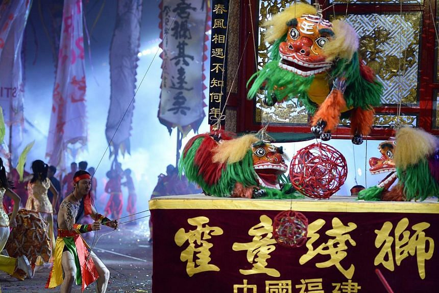 CHINA: The Fujian Ningde Huotong String Lions troupe displaying a local folk art from Fujian province with 1,000 years of history, which involves a performer using strings to control lion puppets. -- ST PHOTOS: LIM SIN THAI, DESMOND LIM