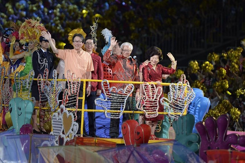 President Tony Tan Keng Yam and his wife Mary waving at the crowds from the top of a float during the Chingay Parade yesterday. -- ST PHOTOS: LIM SIN THAI, DESMOND LIM