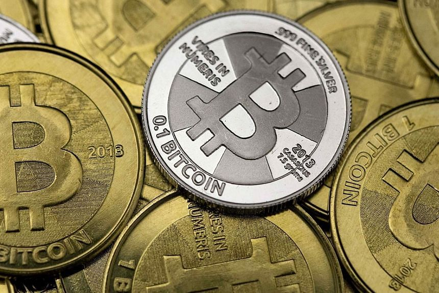 Some of Bitcoin enthusiast Mike Caldwell's coins are pictured at his office in this photo illustration in Sandy, Utah, Jan 31, 2014.Russian authorities have issued warnings against using Bitcoin, saying the virtual currency could be used for mo