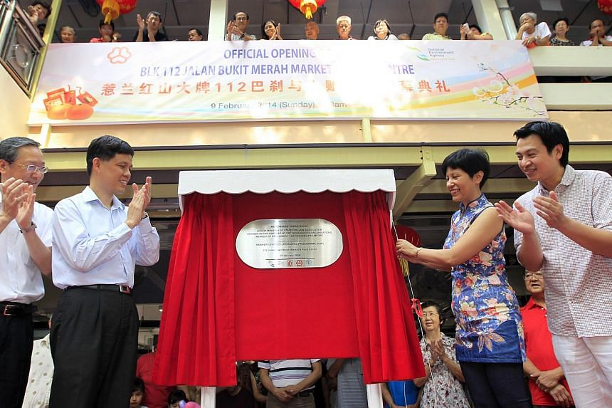 Grassroots advisor Mr Chan Chun Sing (second, left), Minister for Social and Family Development and Second Minister for Defence, Ms Indranee Rajah (second, right), Senior Minister of State for Law and Education, grassroots advisors Mr Sam Tan (left)