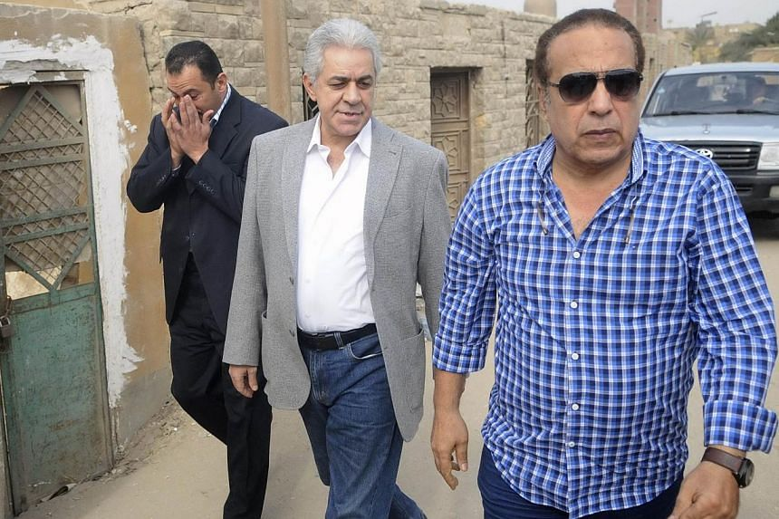 Mr Hamdeen Sabbahi (centre) arriving at the funeral prayers of prominent Egyptian poet Ahmed Fouad Negm at Al-Hussein mosque in Cairo on Dec 3, 2013. Mr Sabbahi  said on Saturday, Feb 8, 2014, he will stand in upcoming elections, in a conte