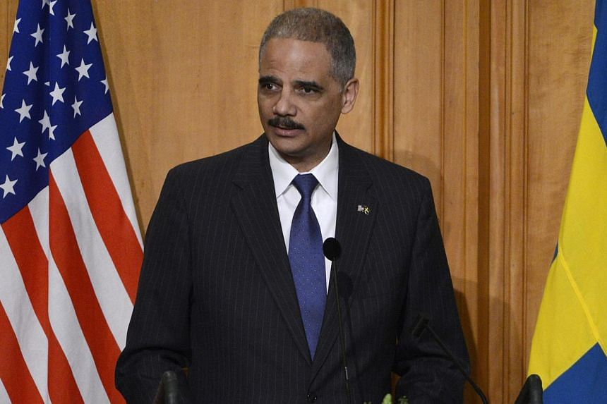 US Attorney General Eric Holder will expand government recognition of same-sex marriages in all federal courtrooms and prisons on Monday, Feb 10, 2014, and ensure they receive the same benefits as heterosexual ones. -- FILE PHOTO: REUTERS