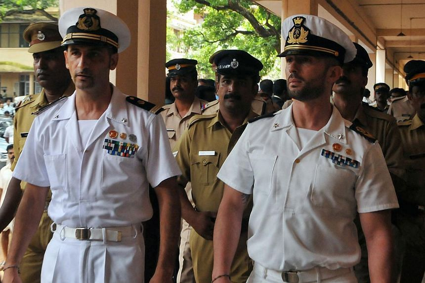 Italian marines Latore Massimiliano (second, left) and Salvatore Girone (second, right) are escorted by Indian police outside a court in Kollam on May 25, 2012. Rome harshly criticised an Indian decision to try two Italian marines accused of killing