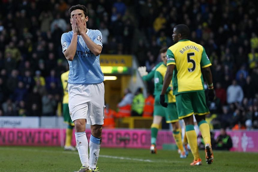 Manchester City's Jesus Navas just after missing a scoring opportunity against Norwich City during their English Premier League match at Carrow Road in Norwich, eastern England on Feb 8, 2014. Manchester City failed to regain pole position in the Pre
