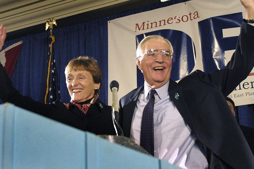 Democratic Senate candidate and former Vice-President Walter Mondale and his wife Joan wave to supporters from the stage at his election night headquarters in St.Paul, Minnesota on Nov 5, 2002. Family and friends of Joan Mondale gathered on Saturday