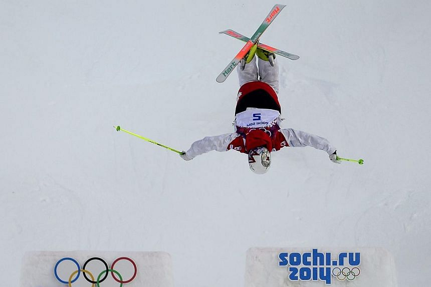 Canada's Maxime Dufour-Lapointe competes in the Women's Freestyle Skiing Moguls qualifications at the Rosa Khutor Extreme Park during the Sochi Winter Olympics on Feb 6, 2014. -- FILE PHOTO: AFP