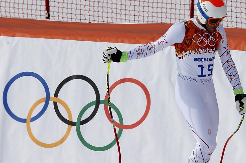 Bode Miller of the U.S. reacts in the finish area after competing in the men's alpine skiing downhill race during the 2014 Sochi Winter Olympics at the Rosa Khutor Alpine Center, Feb 9, 2014.Race favourite Bode Miller failed to get on the podiu