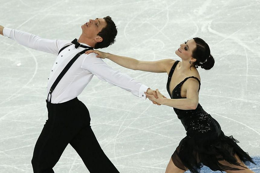 Canada's Tessa Virtue and Canada's Scott Moir perform in the Figure Skating Team Ice Dance Short Dance at the Iceberg Skating Palace during the Sochi Winter Olympics on Feb 8, 2014. Russian officials on Sunday angrily denied a story that they were co