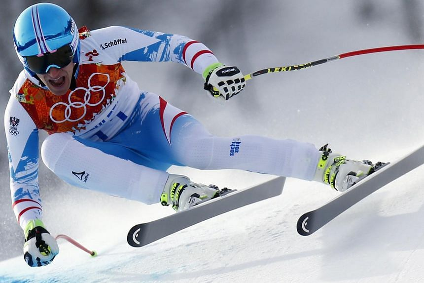 Austria's Matthias Mayer skis in the men's alpine skiing downhill race during the 2014 Sochi Winter Olympics at the Rosa Khutor Alpine Center, Feb 9, 2014. -- PHOTO: REUTERS