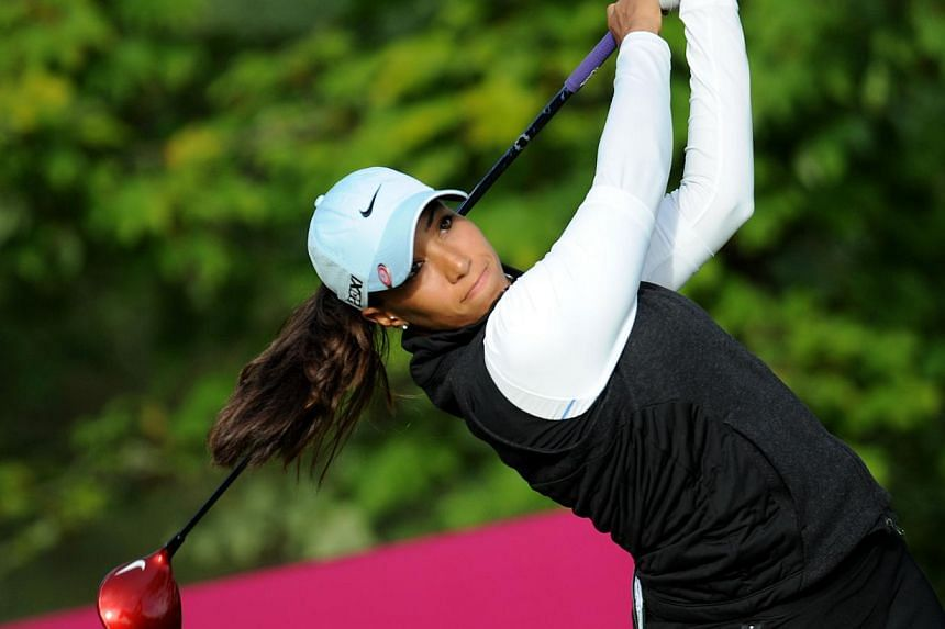 US golfer Cheyenne Woods hittinga drive during the Evian Championship on Sept 14, 2013 in Evian-les-Bains, French Alps. Tiger Woods' niece stepped out of her superstar uncle's shadow on Sunday, Feb 09, 2014, by winning the biggest tournament of her c