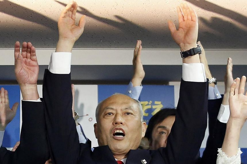 """Japan's former health minister Yoichi Masuzoe shouts """"banzai"""" (cheers) with his supporters at his office, following local media reports that it is certain he will be elected as the new Tokyo Governor, in Tokyo on Feb 9, 2014. Prime Minister Shinzo Ab"""