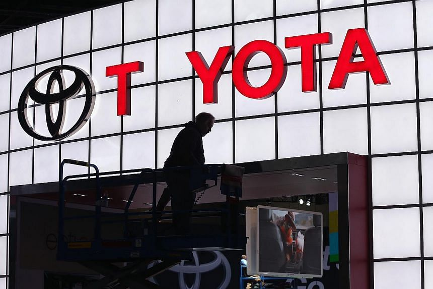 A worker prepares the Toyota display at the Chicago Auto Show on Feb 5, 2014 in Chicago, Illinois. Toyota said on Monday it would stop making cars in Australia in a move that would leave the country with no auto manufacturing, despite appe