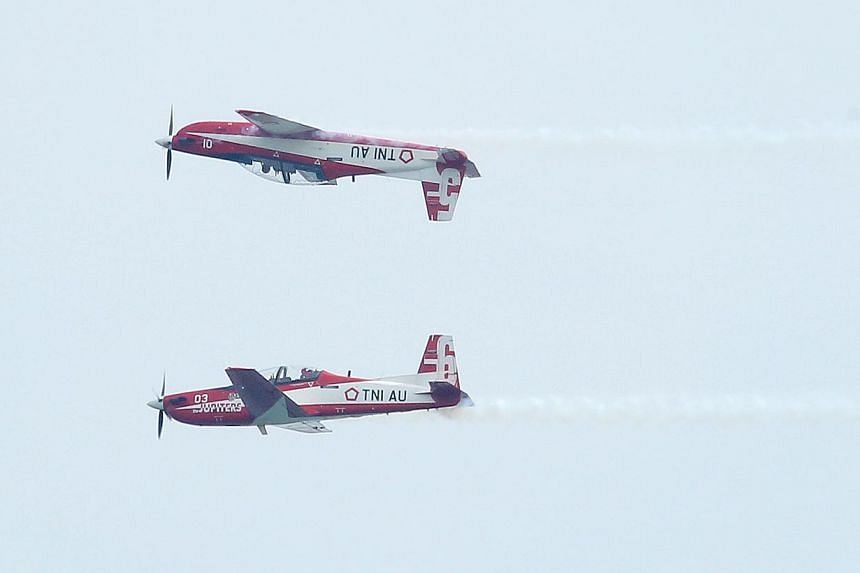 Indonesia Air Force's Jupiter Aerobatic team showing theiraerial display at the Singapore Airshow 2014 on Feb 9, 2014. A topIndonesian naval officer and other military staff have been told that their invitations to the Singapore Airshow h
