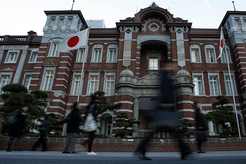 Japan's outstanding government debt rose to a record at the end of last year, data from the finance ministry showed on Monday, highlighting the worsening state of public finances in a country that has the world's largest debt burden. -- FILE PHOTO: R