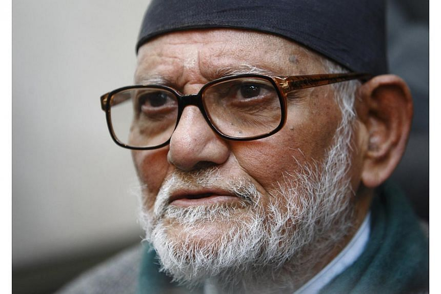 Sushil Koirala, Chairman and parliamentary party leader for the Nepali Congress Party, speaks with media personnel during a news conference after filing his nomination for the post of prime minister for the election to be held on Monday, at the Parli