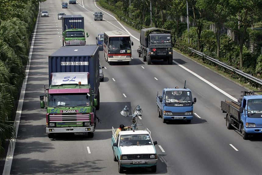 An array of slow and heavy vehicles plying all four lanes of the Pan-Island Expressway on Aug 25, 2009. More people were killed in road accidents involving heavy vehicles last year. -- ST FILE PHOTO: TERENCE TAN