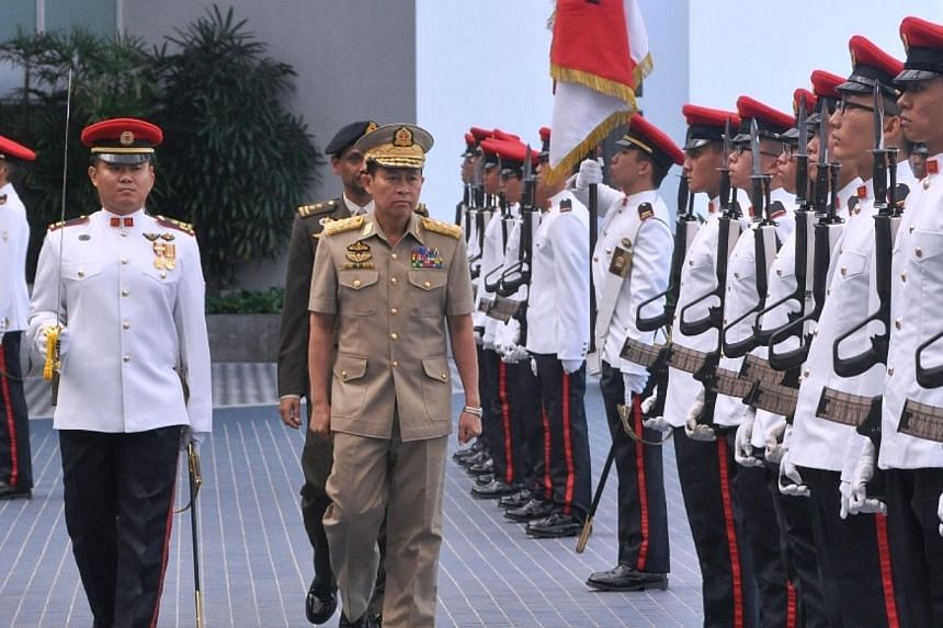 Vice–Senior General Soe Win (centre) inspecting the Guard of Honour at Mindef. -- PHOTO: MINDEF