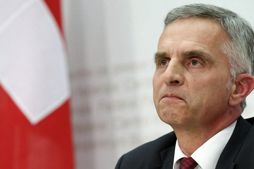 Swiss President and Foreign Minister Didier Burkhalter addressing a news conference on results in Bern on Feb 9, 2014.The European Union said it will review ties with Switzerland after the non-member Alpine country voted to restrict EU immigrat
