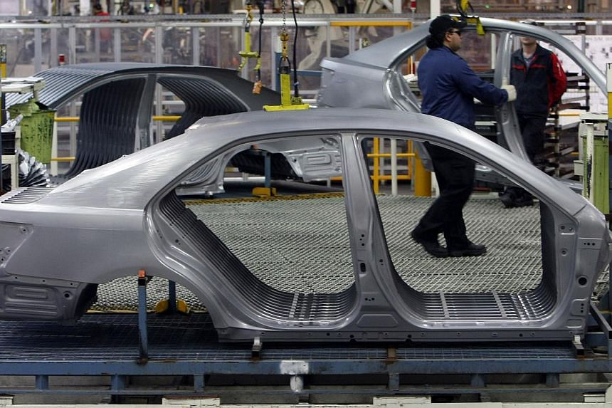 Toyota Camry Hybrid car bodyshells on the assembly line at the Toyota plant in Melbourne in August 2009. Toyota said it would stop making cars in Australia in 2017. -- FILE PHOTO: REUTERS