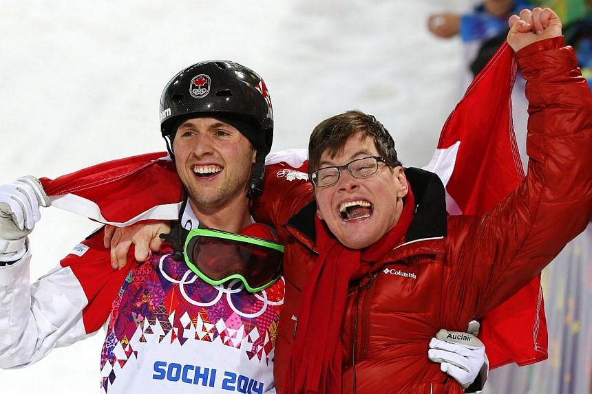 Winner Canada's Alex Bilodeau and his brother Frederic celebrate following freestyle skiing moguls competition at the 2014 Sochi Winter Olympic Games in Rosa Khutor, on Feb 10, 2014. Alex Bilodeau toiled for fours years to retain his Olympic mog
