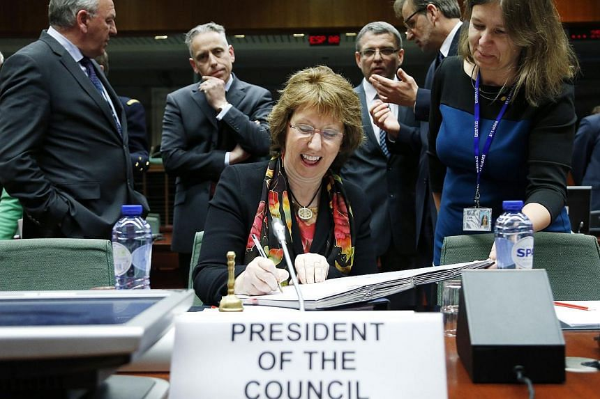EU foreign policy chief Catherine Ashton at the EU foreign ministers meeting in Brussels Feb 10, 2014. The 28-nation bloc endorsed a negotiating mandate for a political and cooperation agreement that ultimately will open the way also to broader