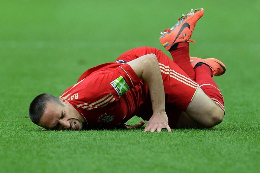 """Bayern Munich's French midfielder Franck Ribery falls on the pitch during the German cup """"DFB Pokal"""" final football match Borussia Dortmund vs Bayern Munich at the Olympiastadion in Berlin on May 12, 2012. Ribery has undergone surgery for bruised but"""