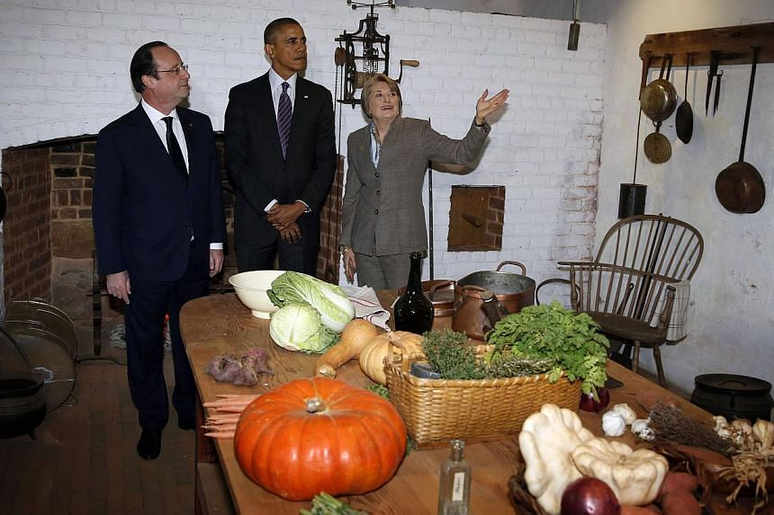 US President Barack Obama (centre) and French President Francois Hollande (left) tour the Virginia residence of Thomas Jefferson with Leslie Greene Bowman, president and CEO of the Thomas Jefferson foundation, at Monticello in Charlottesville, on Feb