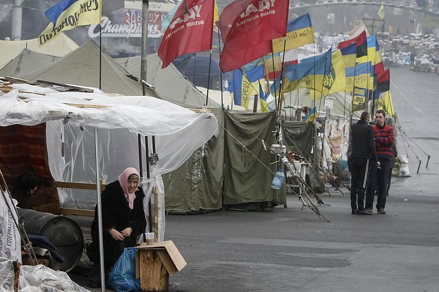 "Anti-government protest camps in central Kiev on Feb 10, 2014. The US House of Representatives voted 381-2 to support ""the Ukrainian people's struggle to build an independent, democratic, and strong Ukraine that is free from foreign meddling"". -- PHO"