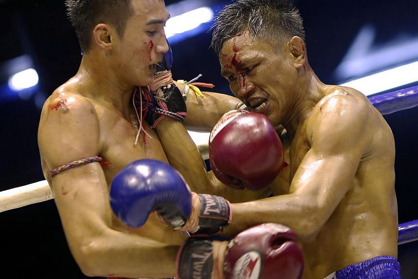Boxers clashing during their fight at Lumpinee stadium, which is to be demolished after 57 years, on Feb 7, 2014. -- FILE PHOTO: REUTERS