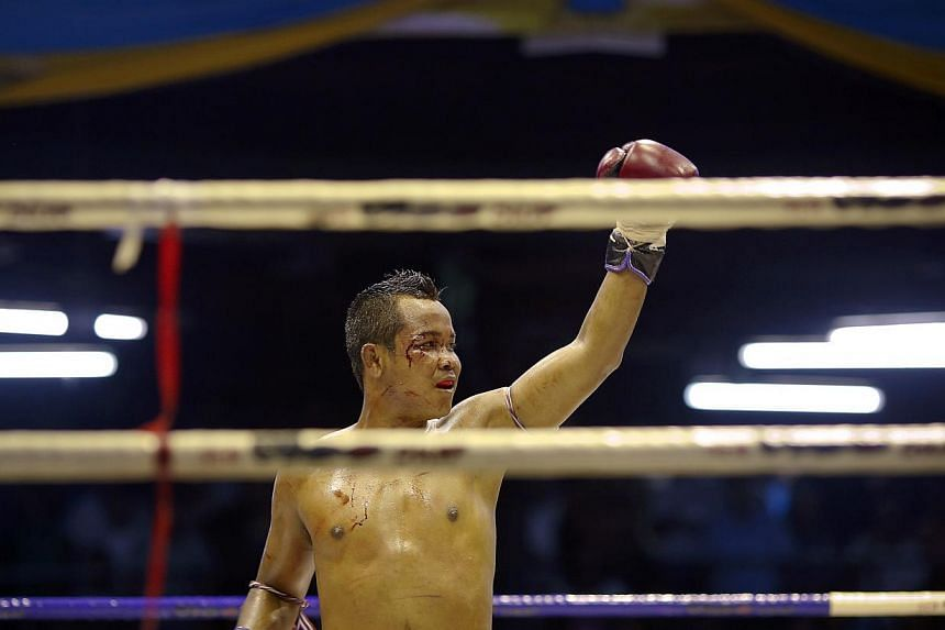 A fighter celebrates his win on Feb 7, 2014. -- FILE PHOTO: REUTERS