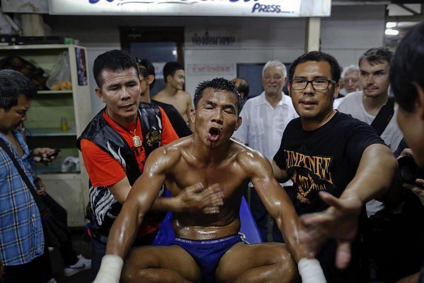 A fighter receiving help after his defeat at Lumpinee stadium on Feb 7, 2014. -- FILE PHOTO: REUTERS