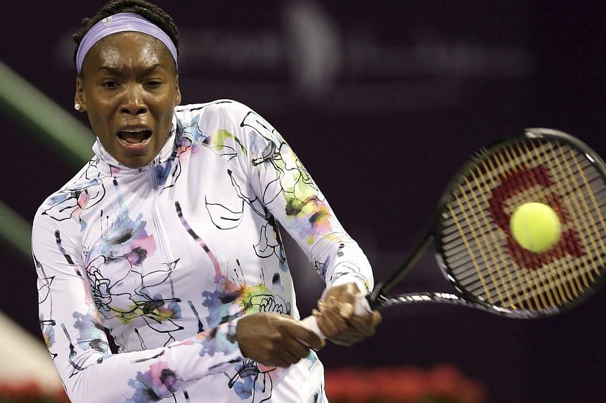 Venus Williams of U.S. returns the ball to Petra Martic of Croatia during their women's singles match at the Qatar Open tennis tournament in Doha, on Feb 10, 2014.Venus Williams, who won the Women's Tennis Association (WTA) season-end champions