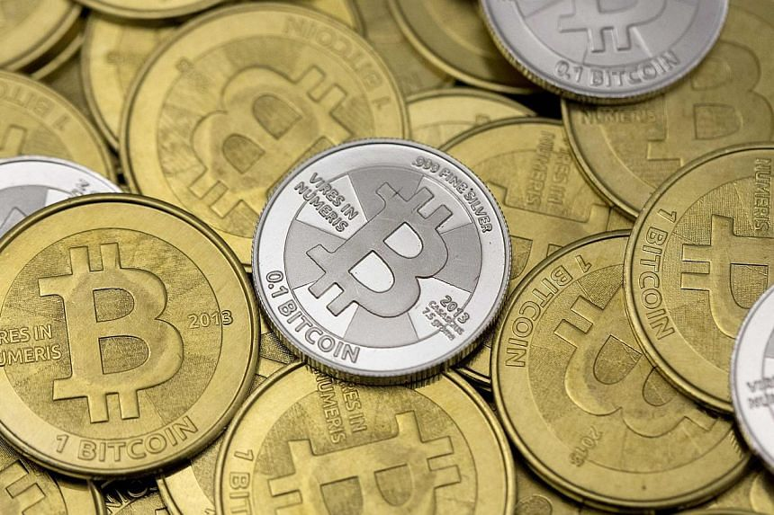 The price of the digital currency bitcoin slid to its lowest level in nearly two months on Monday, Feb 10, 2014, after bitcoin digital marketplace Mt Gox said a halt on withdrawals it announced on Friday would continue indefinitely after it detected