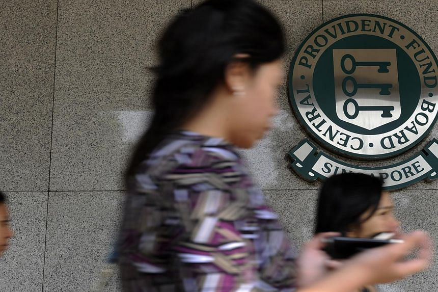 Older Singaporean workers face the pleasant prospect of seeing a rise in their Central Provident Fund (CPF) contributions.-- ST FILE PHOTO: CAROLINE CHIA