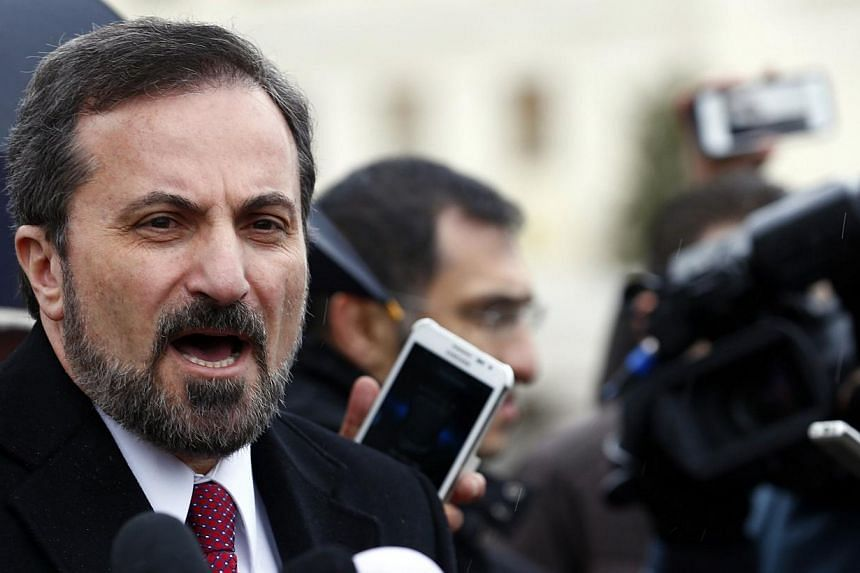 Louay Safi, spokesperson for the Syrian National Coalition, addresses the media after a meeting at the Geneva Conference on Syria, at the United Nations European headquarters in Geneva on Feb 10, 2014. The Syrian opposition delegation in Geneva