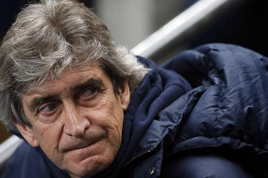 Manchester City's manager Manuel Pellegrini reacts ahead of their FA Cup third round soccer match against Blackburn Rovers at the Etihad stadium in Manchester, northwest England, Jan15, 2014.Pellegrini on Tuesday refused to react to claims from