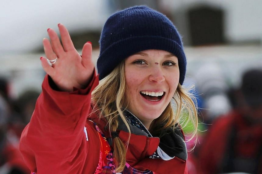 Winner Canada's Dara Howell celebrates after the women's freestyle skiing slopestyle finals at the 2014 Sochi Winter Olympic Games in Rosa Khutor, Feb 11, 2014.Howell nailed her first run in the final to win the first Olympic gold medal in wome