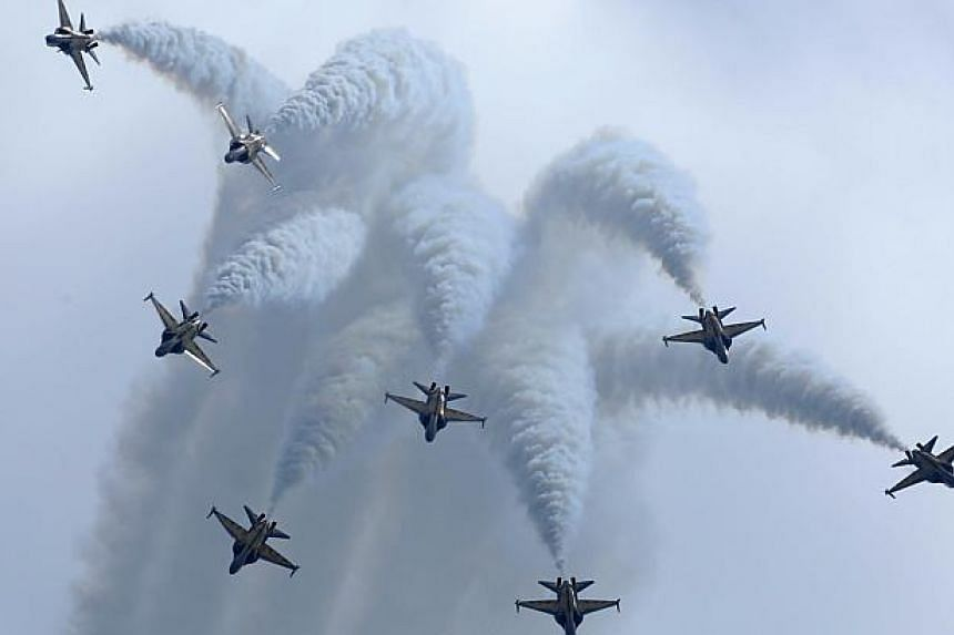The Black Eagles aerobatic team of South Korean Air Force (ROKAF) perform with their T-50 aircraft during the Singapore Airshow in Singapore on Feb 11, 2014. -- PHOTO: REUTERS