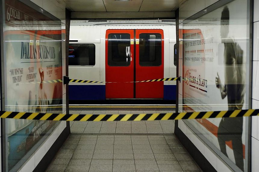 An empty tube train is seen at a cordoned off platform during rush hour at Oxford Circus underground station in London Feb 5, 2014. Trade unions called off a planned strike on the London Underground train network on Tuesday just hours before it was d